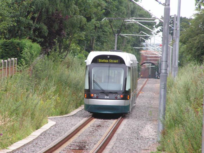 Light rail vehicle on single track with greenery on both sides