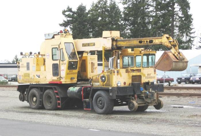 A yellow maintenance vehicle in front of the tracks