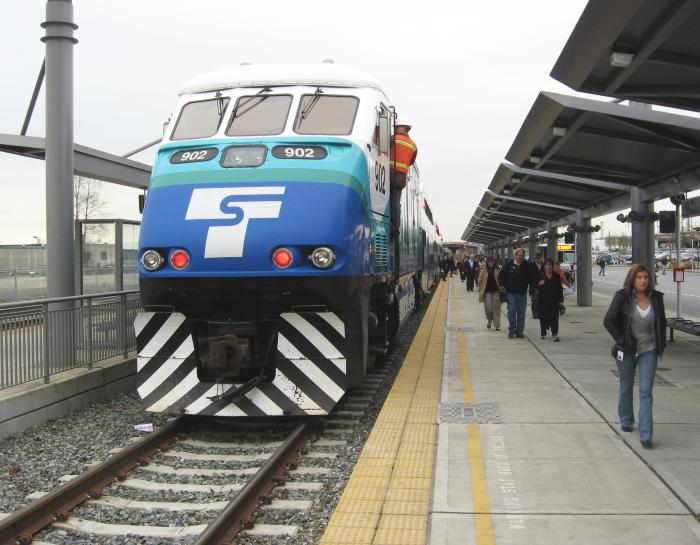 Large, blue diesel locomotive in station